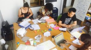 COCo staff team at a big desk working