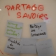decoratve; whiteboard that has partage savoirs written on it