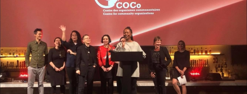 COCo team on stage accepting an award