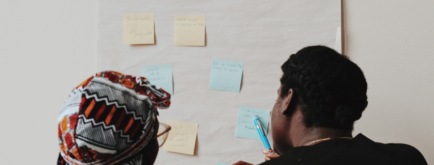 two people looking at a flipchart